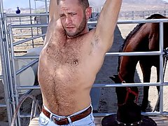 This sexy stud is getting naked out by the corrals
