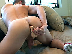 Mason strokes his dick and switches for a big toy in his ass