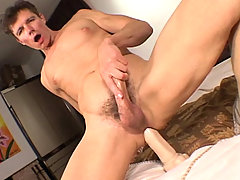 Hot DILF enjoying some intense dildo ana toying in this one