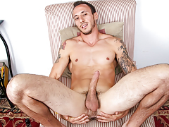horny muscly guy with tattoos jerks off his great big cock